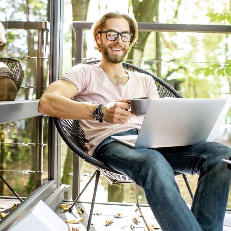 creative-man-working-outdoors-at-the-forest-house | how to spark creativity in the workplace