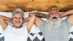 Happy senior couple in bed | penis exercises | featured | ss