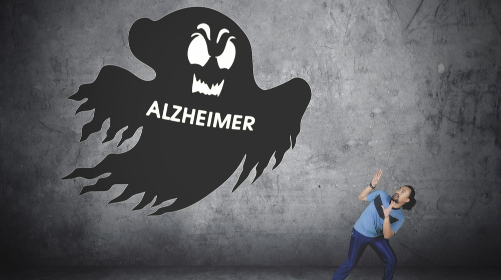 Picture of Afro man wearing sportswear while running away from a ghost with Alzheimer word | alzheimers disease | avoid alzheimers