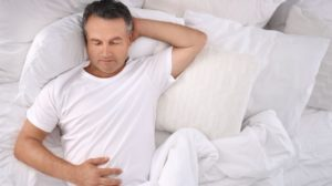 man-sleeping-on-comfortable-pillow-bed How Sleep Can Affect Your Date And Other Facts | Featured