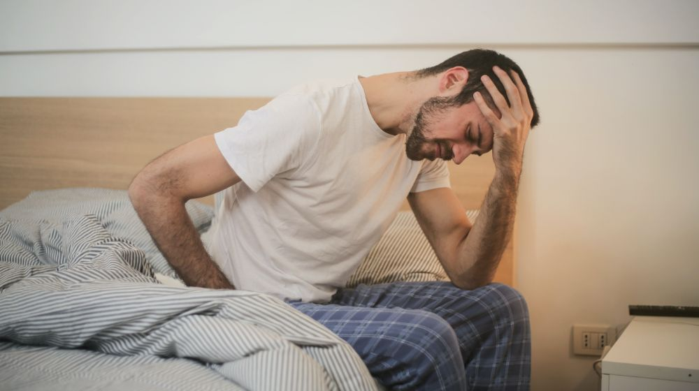 Young Man Suffering | Common Health Problems | Featured