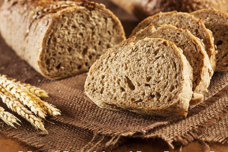 fresh homemade whole wheat bread on | foods that lower high blood pressure list