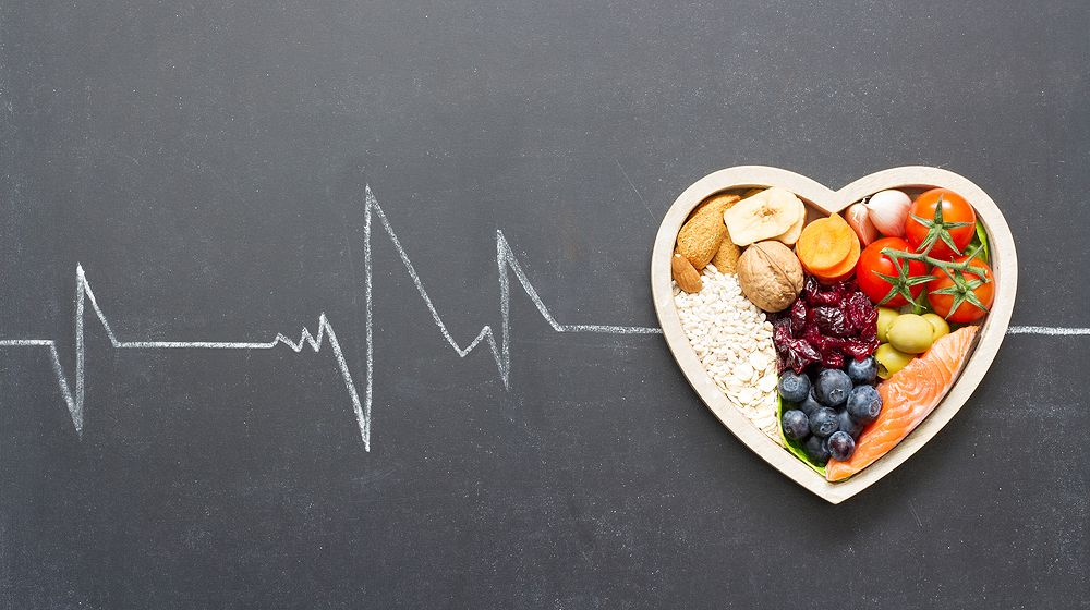 healthy food heart cardiograph on blackboard | Foods to Lower High Blood Pressure Without Medication | Featured