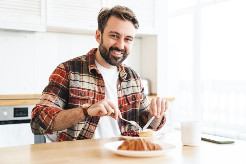 Man Eating in Kitchen   Strength Training
