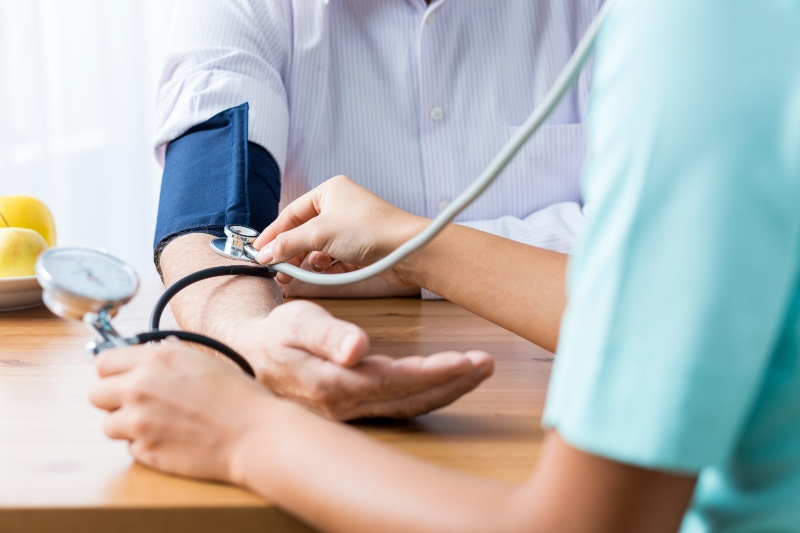 Patient and Doctor Taking Blood Pressure   Stress Symptoms