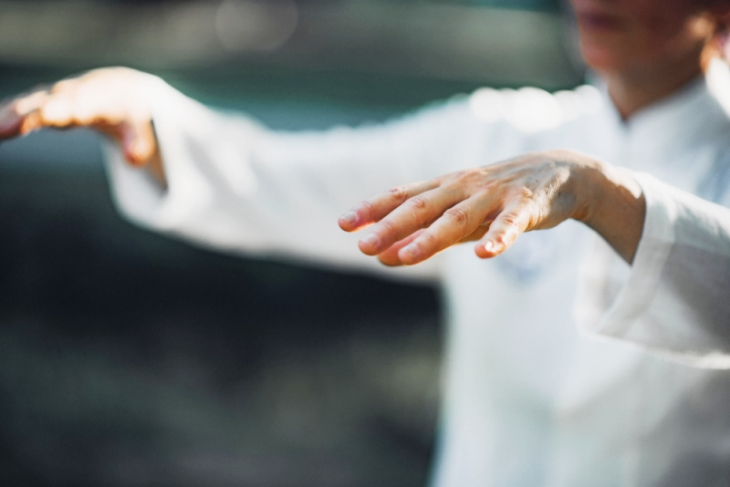 woman practicing tai chi quan park   old people sports