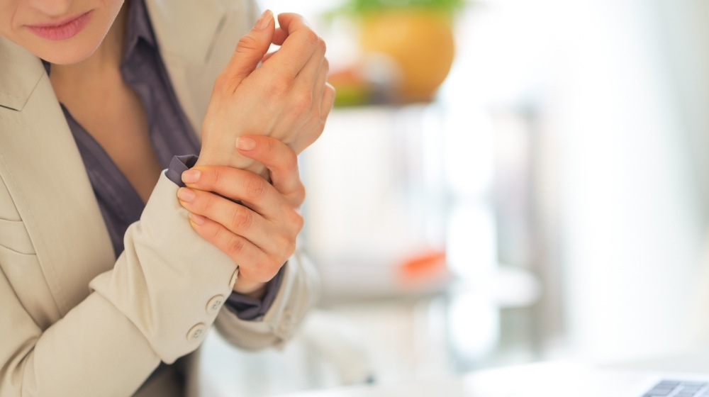 Woman with Wrist Pain | Menopause and Joint Pain | Featured